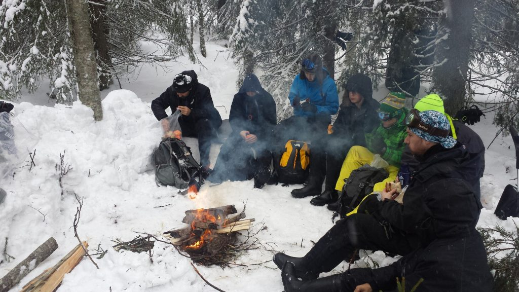 Lunchtime around a small fire to keep warm in the Arctic