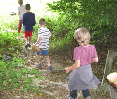 Bushcraft kids off foraging in the woods