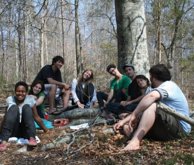 Group of students in the woods together