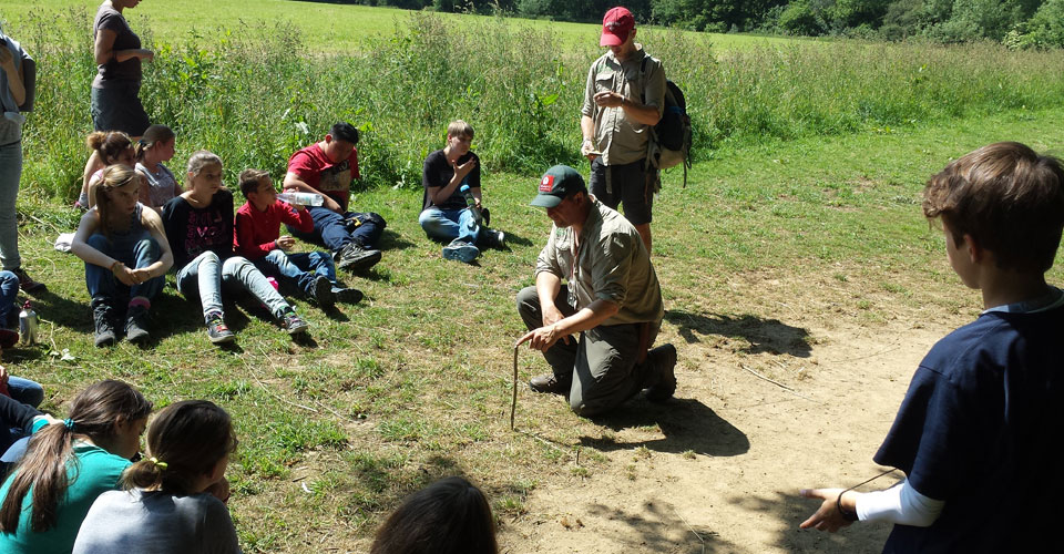 Navigating using sticks and shadows! The group is finding out how from one of the instructors.
