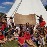Really Wild Home Education Gathering Group Photo. Lots of children from all walks of life coming together at the Wild Festival to share their skills and have great fun in the sun.